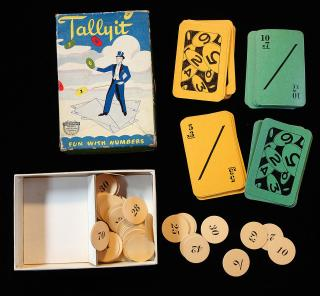 "Tallyit - Fun with Numbers - Image of Magician standing on Cards tossing ""Tally Totals"" in the Air."