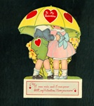 Valentine Couple Hiding under Mechanical Umbrella